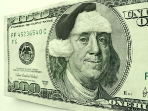 Ben Franklin is in the Christmas Spirit for the Holiday's wearing a Santa Hat and a smile | courtesy of Ricardo Reitmeyer | shuttershock.com
